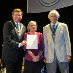 Mr Steve Jones, President of the World Federation of Rose Societies presents the Garden of Excellence Award to Rachel Solomon, Curator of the Lady Norwood Rose Garden and Doug Grant, New Zealand Rose Society.